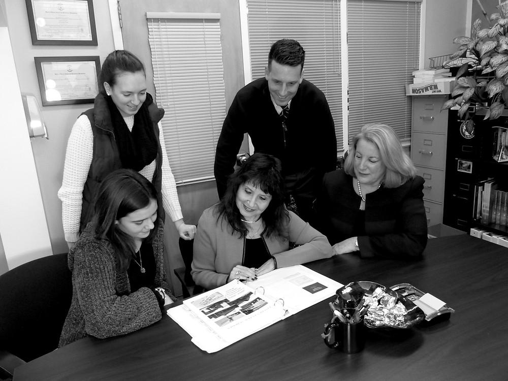 Superintendent Georgia Fortunato meets with (l to r) Julia Lombardi, Hailey Joyce, Principal Kevin McNamara and Business Manager Lori Miller.  Photo: Isabella Carpano