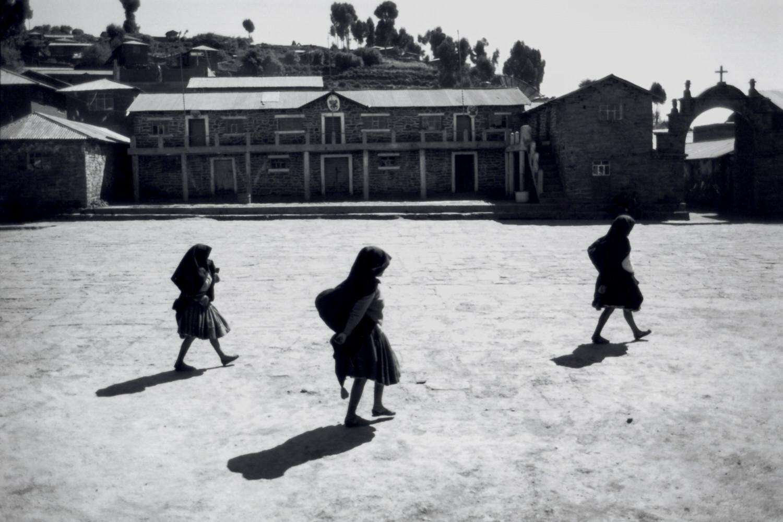 3 women crossing the village square