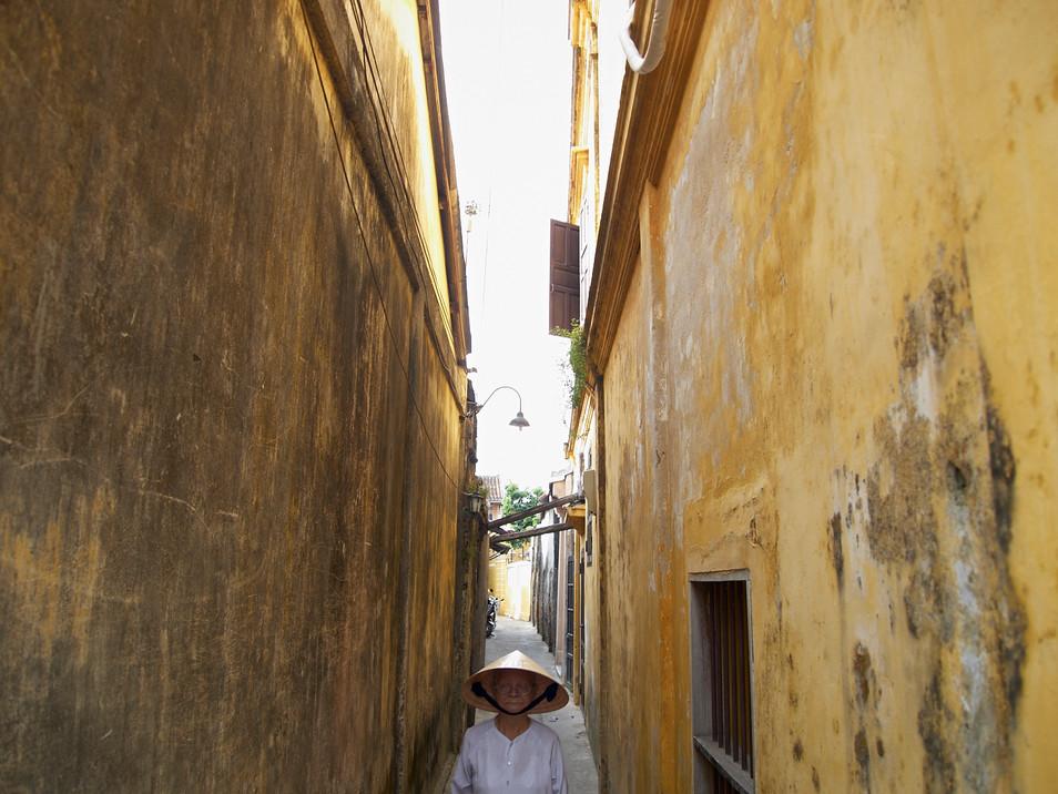 Old woman in the yellow corridor