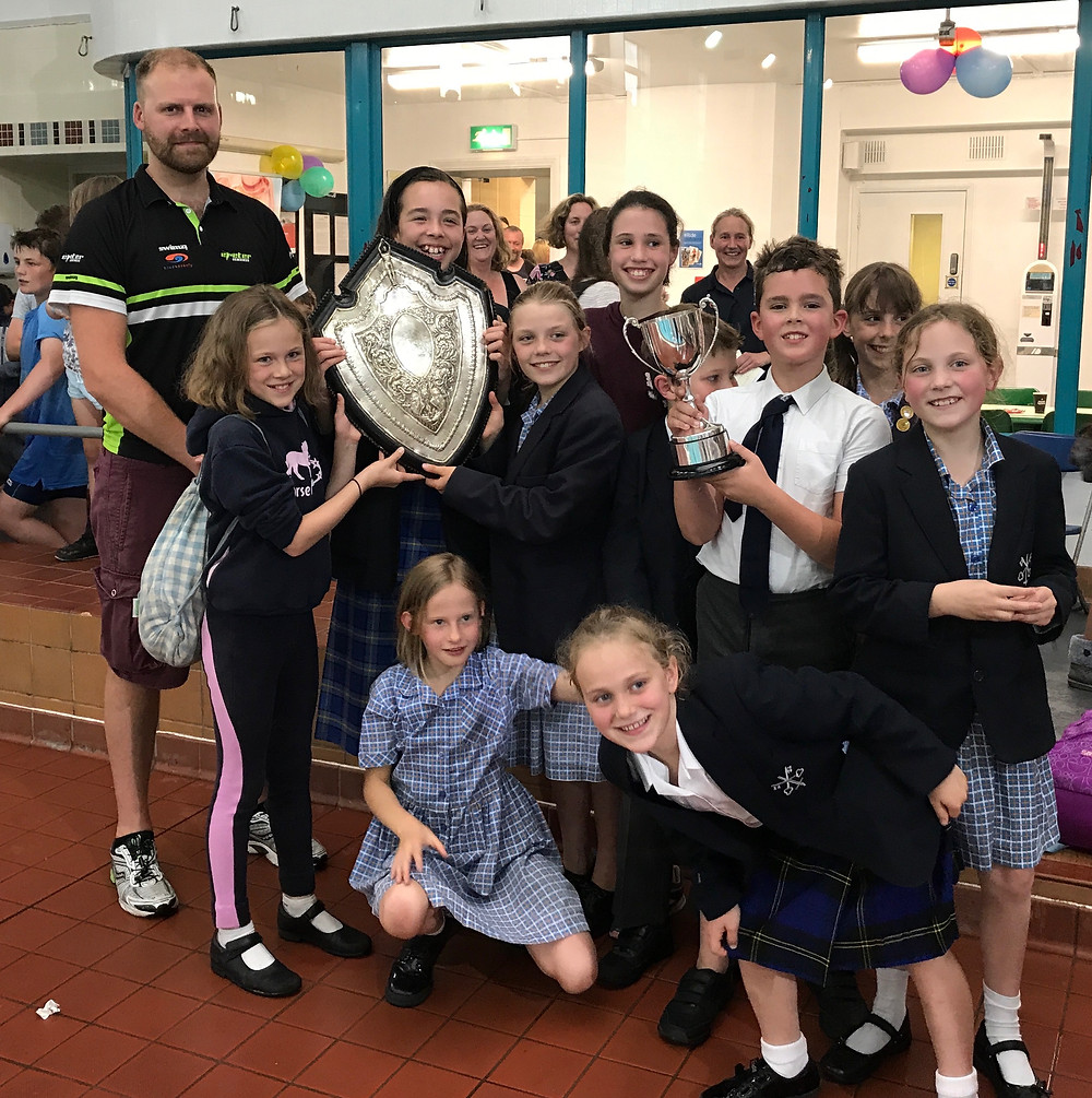 Exeter Cathedral School with their trophies and ECSC Chair - Dean Drury