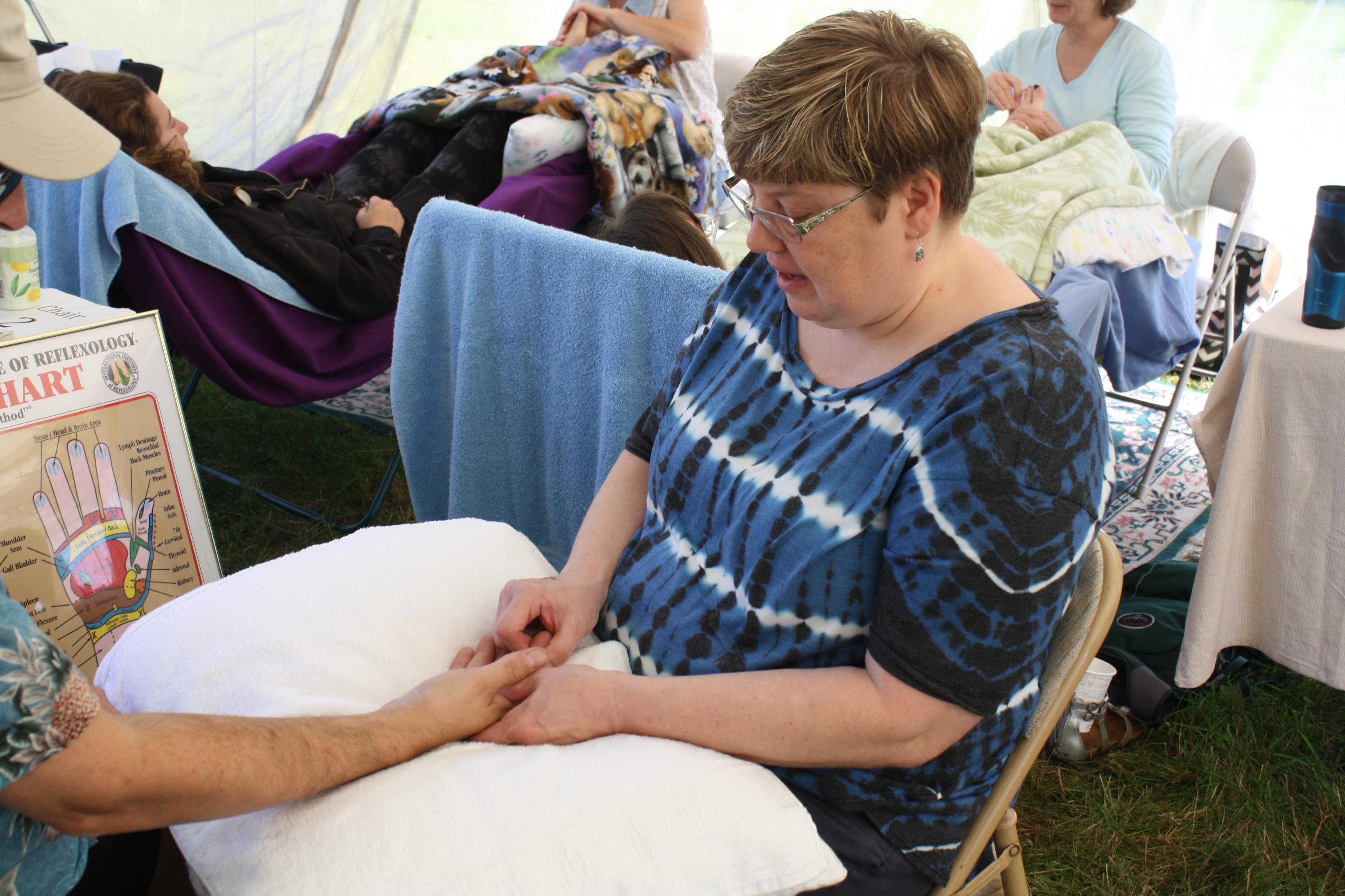 Hand reflexology at the fair