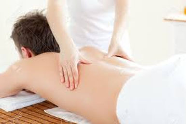 Man receiving a Calm Waves HypnoBirthing holistic massage treatment