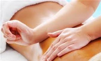 Man receiving a Calm Waves HypnoBirthing holistic massage treatment