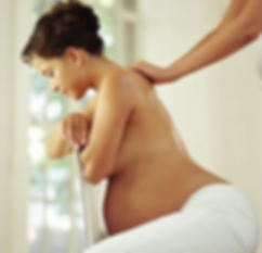 Pregnant mum receiving a Calm Waves HypnoBirthing labour massage