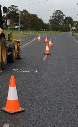 Traffic control cones on road sectioning off a zone for the machinery.jpg