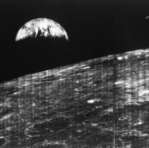 A grainy, black and white picture showing Earth from the Moon