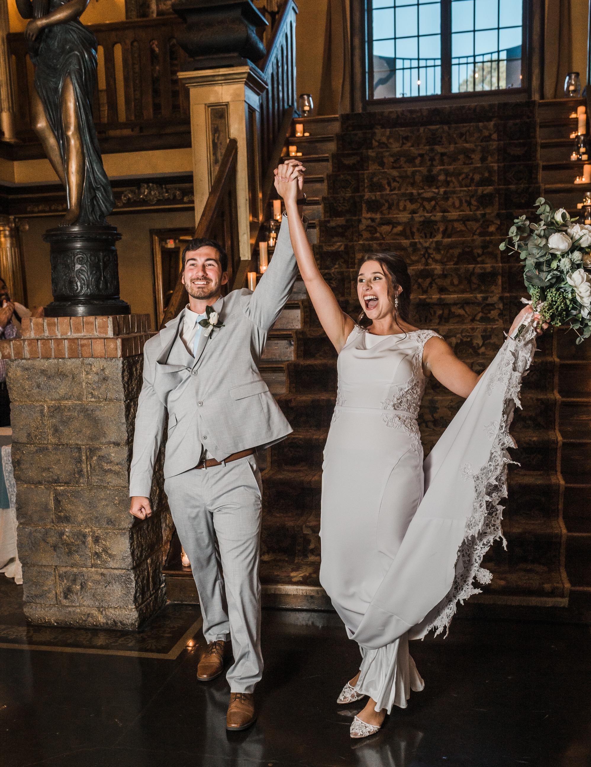 grand entrance into wedding reception, newlywed smile, bride dress, wedding shop