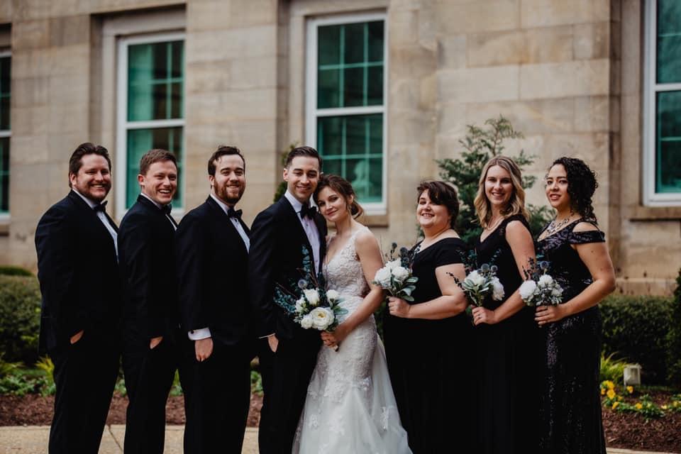 small wedding party, bridesmaids in black, matching groomsmen suits, thegroomsmansuit