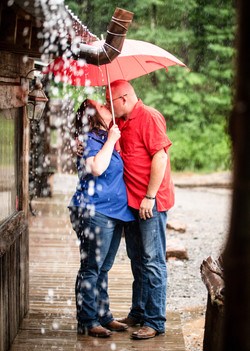 rainy wedding, bride and groom, army wedding, military wedding, marine wedding, clear umbrellas, bar