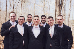 wedding day timeline with groom time to relax and enjoy groomsmen with pink ties