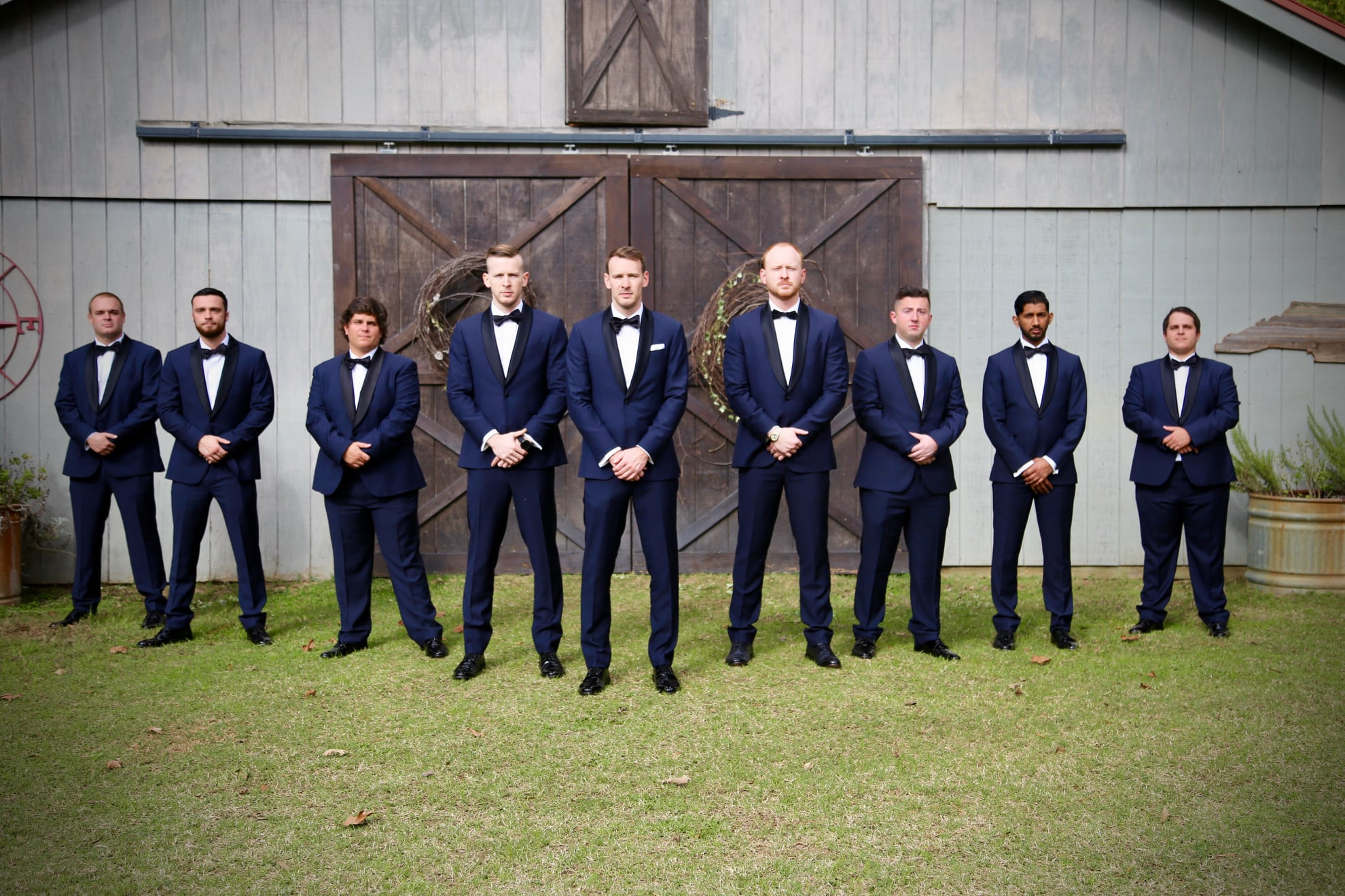 Groomsmen photo ideas and inspiration with groom navy blue suit
