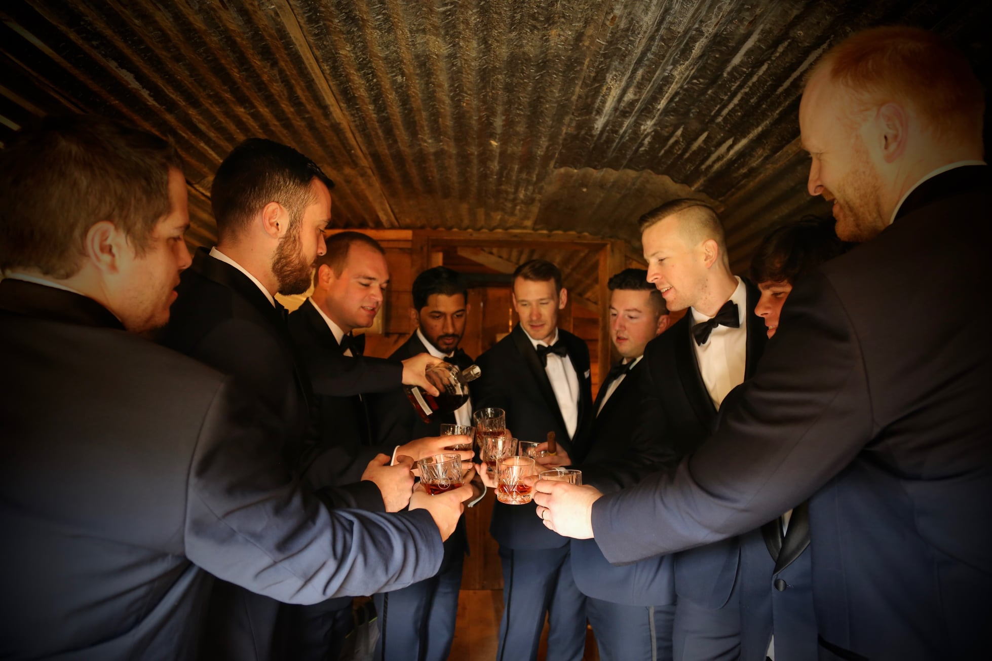 groomsmen cheers with wedding whiskey, father of the bride cheers
