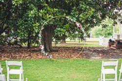 faux floral circle arbor outdoor wedding ceremony