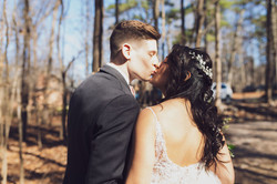 Nine19 Photography Raleigh NC Wedding Photographer kiss in the woods princess bride bride accesories