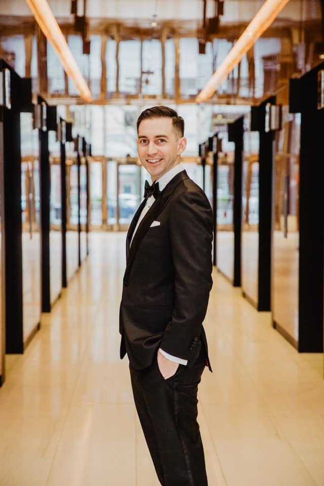 urban wedding groom in city club raleigh lobby groom looking dapper downtown raleigh wedding