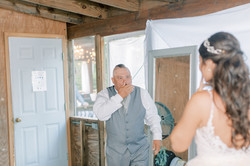 first look with dad, father of the bride, grey groomsmen suit, wren bridal, annapolis bridal shop, w