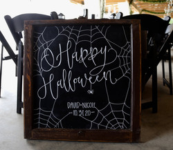 Elegant halloween wedding and chalkboard wedding sign