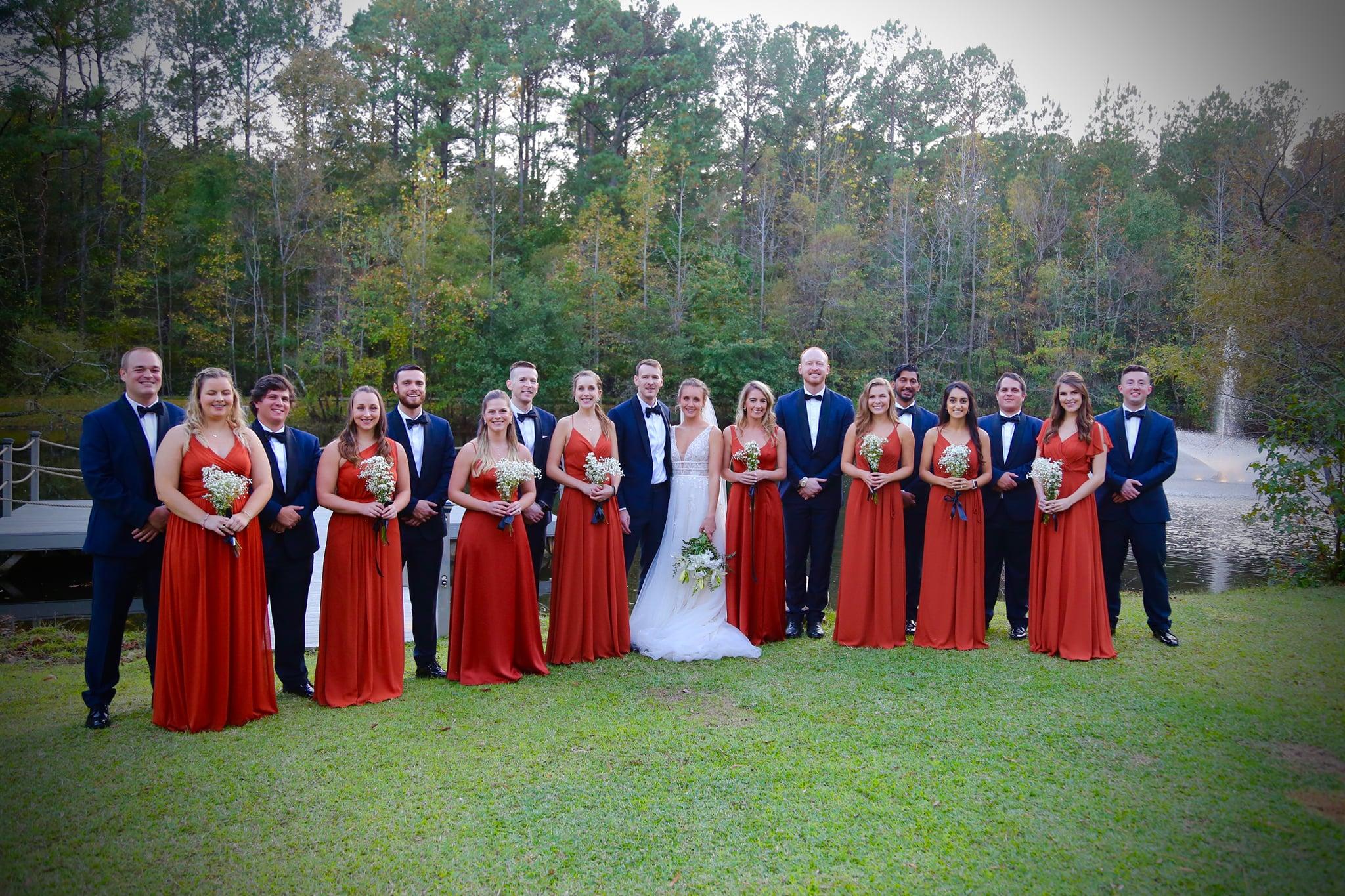 wedding party photo inspiration with burnt orange bridesmaid dresses