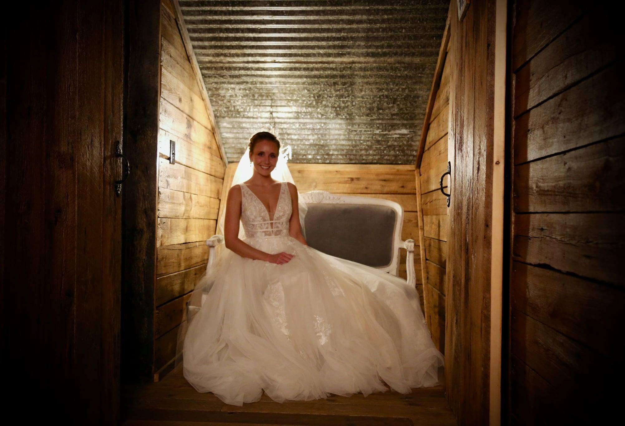 elegant and class bride with wedding garter in barn wedding
