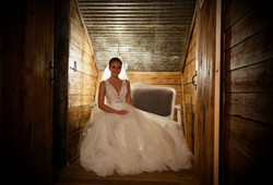 elegant and class bride with wedding garter in barn wedding