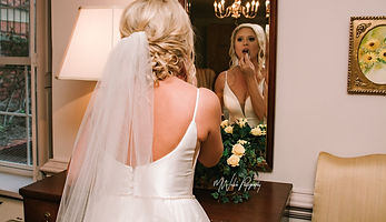 bride makeup touchup in raleigh nc perfect wedding venue in north carolina, barn wedding chandelier and greenhouse wedding reception