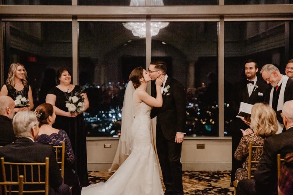 first kiss wedding bride and groom chandelier venue rooftop venue penthouse wedding venue