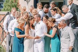 bride and groom family photo, proposal in maryland, hotel weyanoke, praying on stairs, wedding party