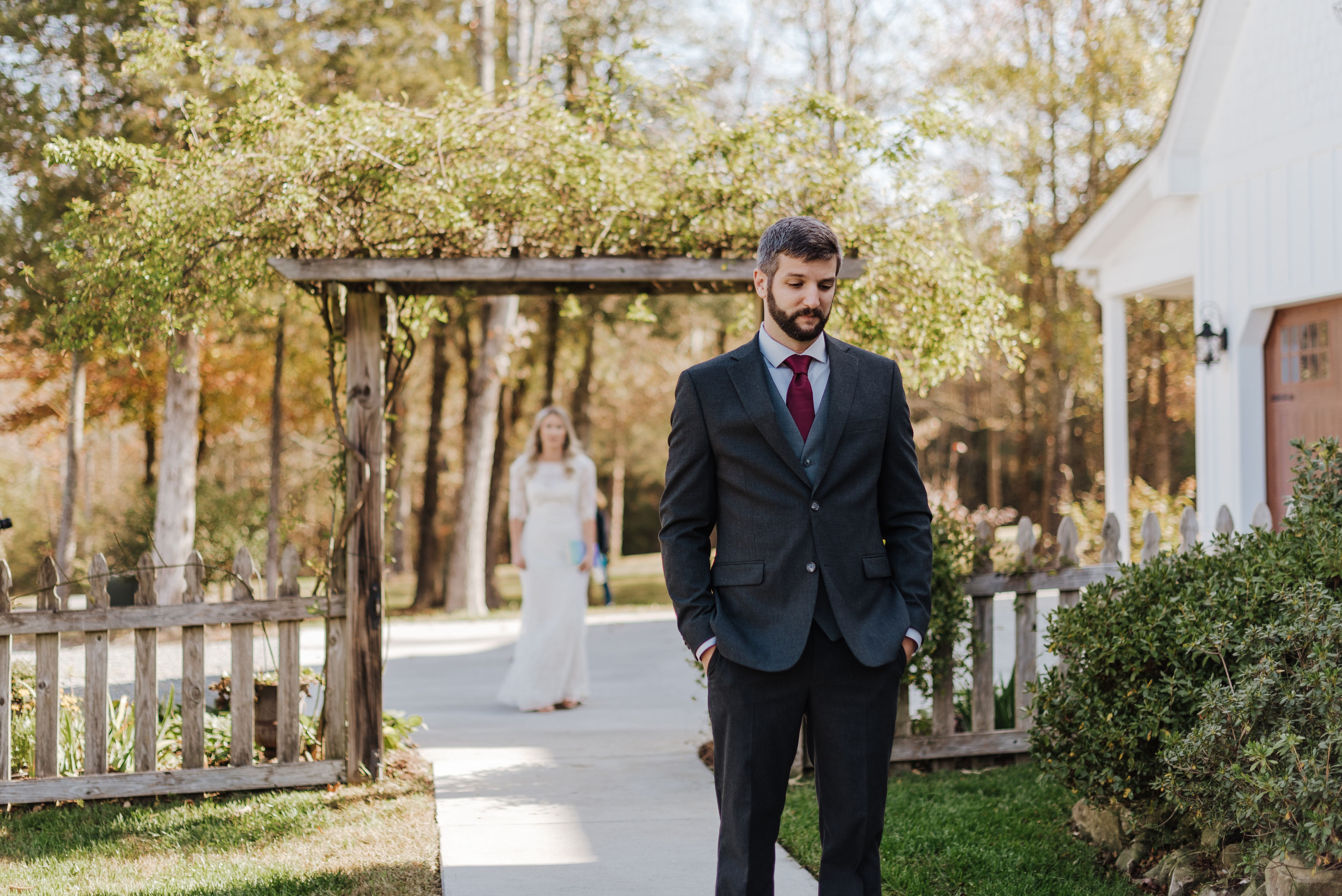 groom reaction to wedding dress during first look in fall wedding