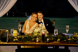 hallowen wedding sweetheart table with unique toasting glasses at outdoor pavilion wedding