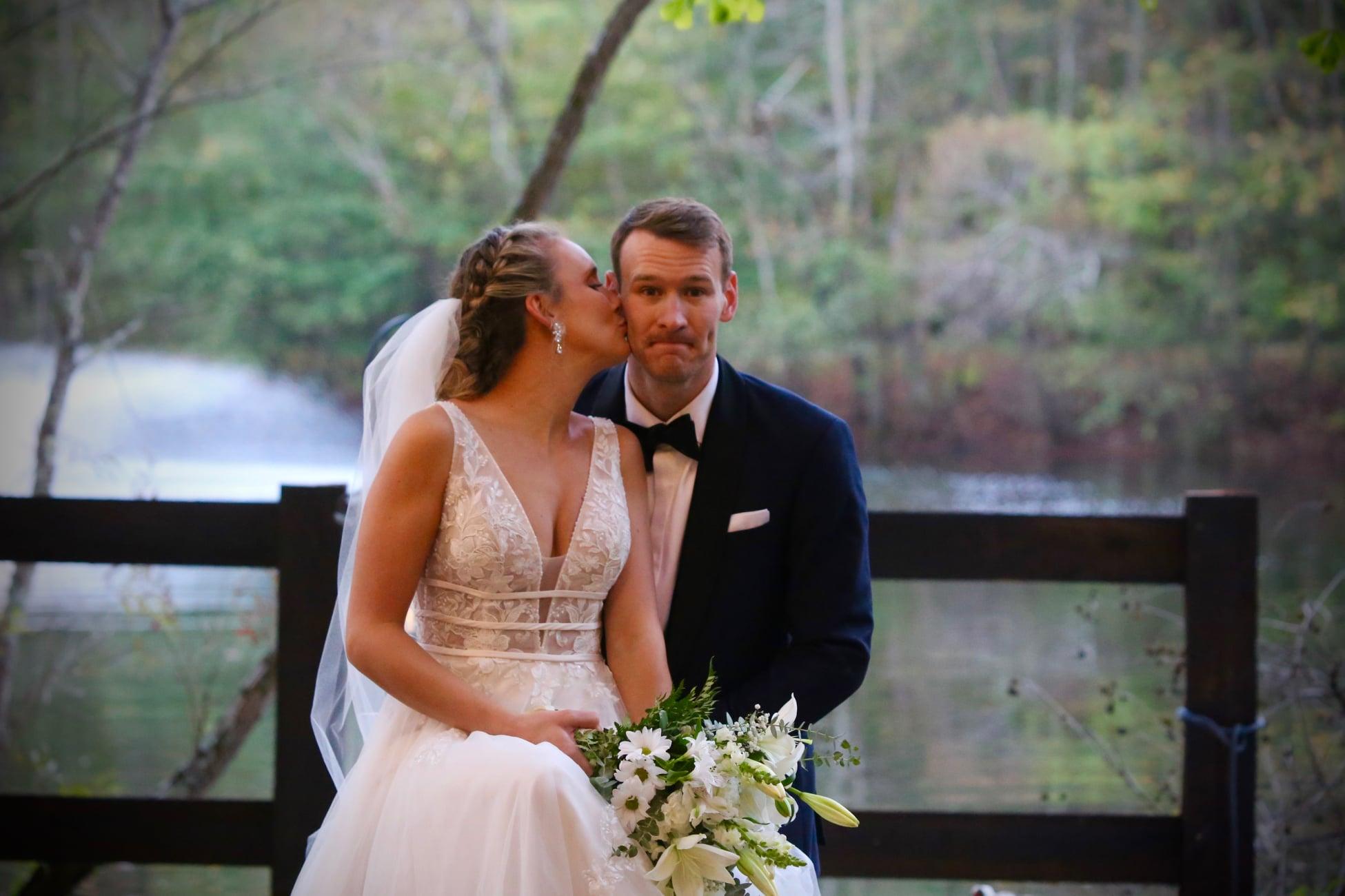 unique groom photo on wedding day with bride