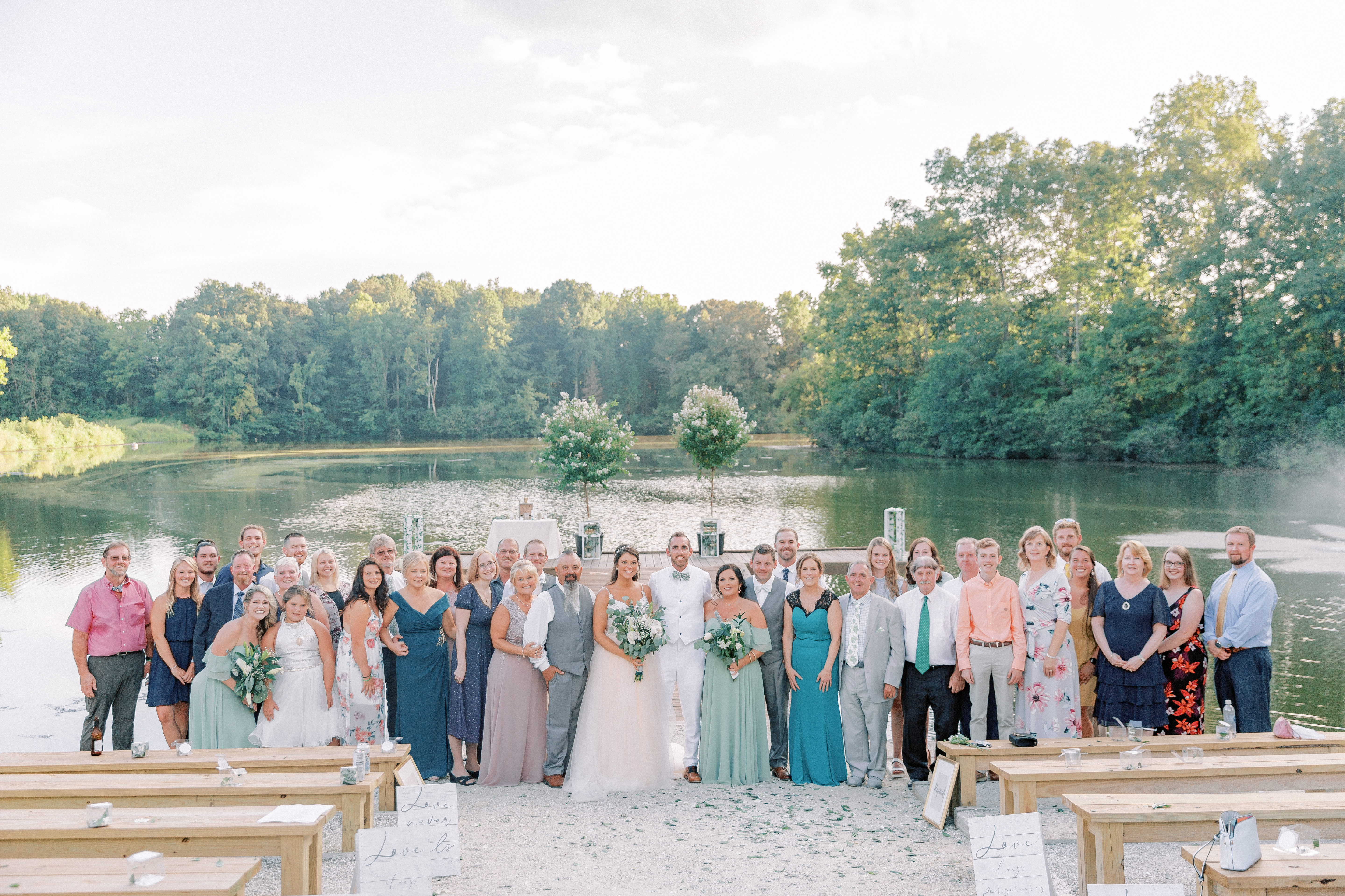 Large extended family photo on wedding day, wedding on a lake, lake wedding, pavilion wedding