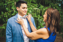 groom and mom fixing bowtie