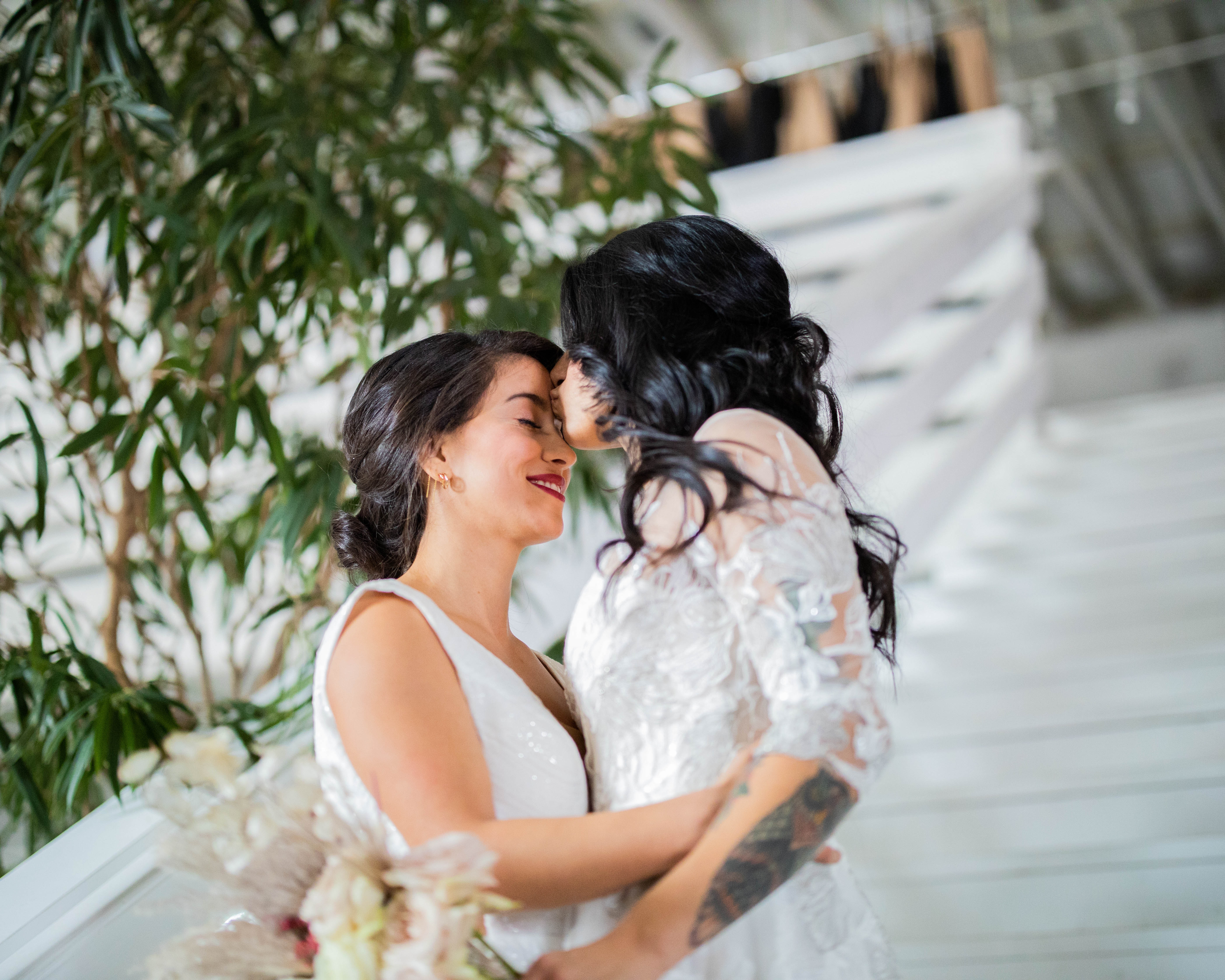 woman-in-white-floral-dress-kissing-woma