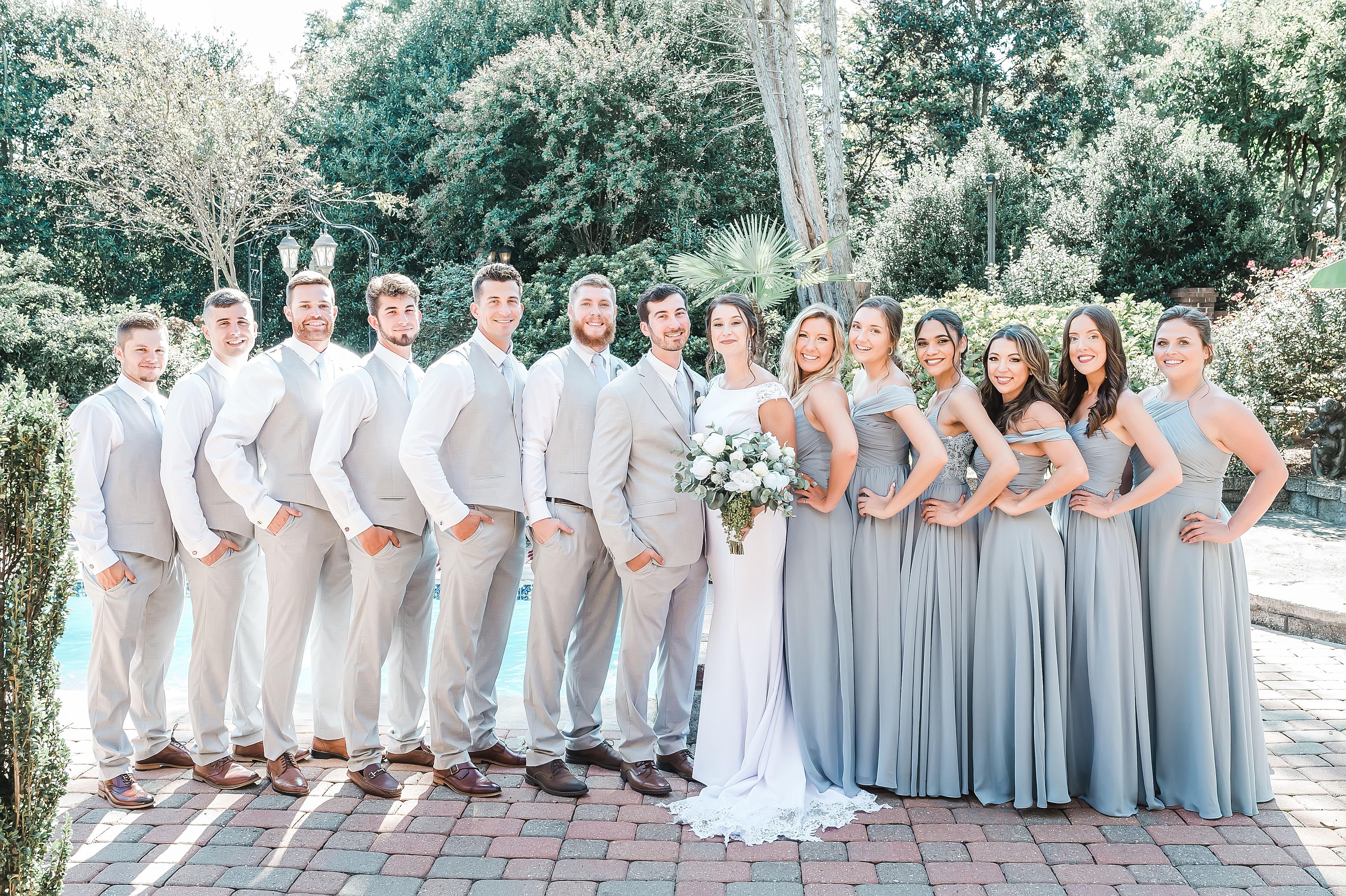 formal wedding party photos, dusty blue bridesmaids dresses, sandy groomsmen suits