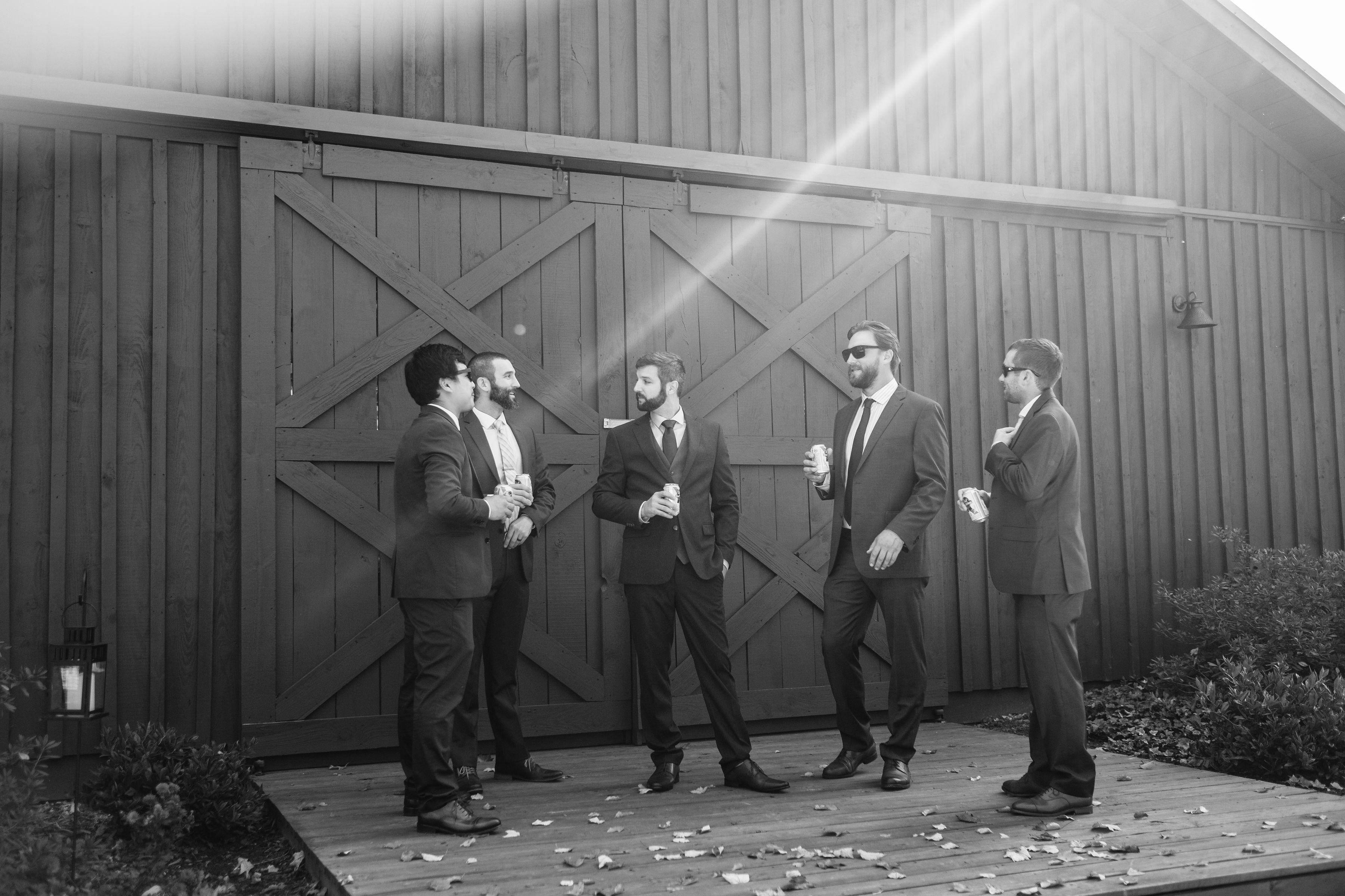 the men in black wedding photo groomsmen hold my beer