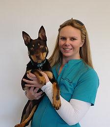Steph Robertson, Head Veterinary Nurse at Brudine Veterinary Hospital with a Kelpie dog