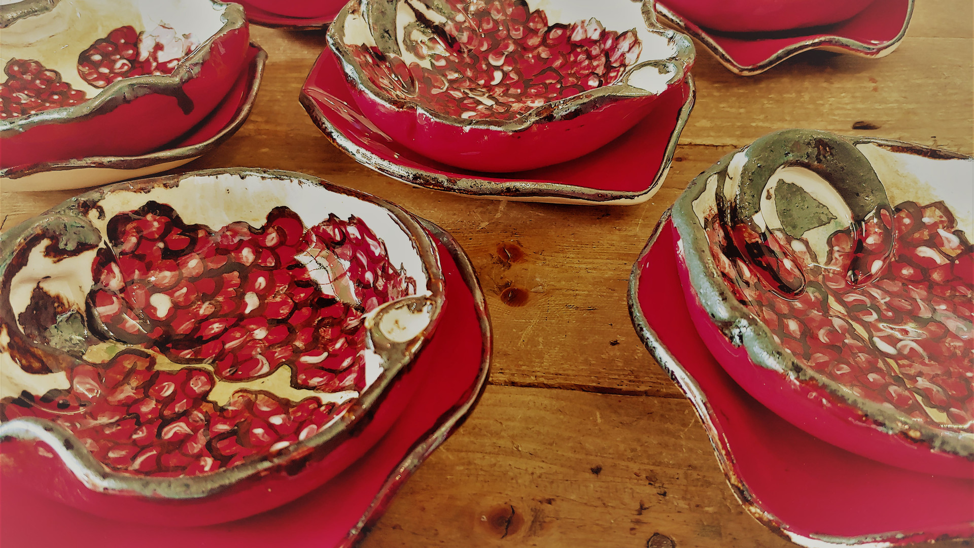 Pomegranate Bowls on litlle Red plates 0