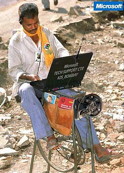 tech support man using latop