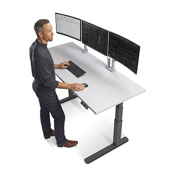 standing desk with three monitors