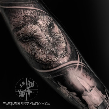 Owl and candel tattoo by James Brennan