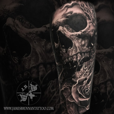 skull and rose tattoo by james brennan of james brennan tattoos