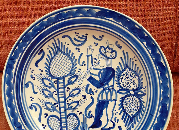 Plato cerámica flautista