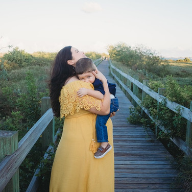 pregnant mother holder toddler son