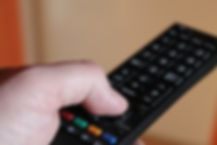 Hand holding a television remote control