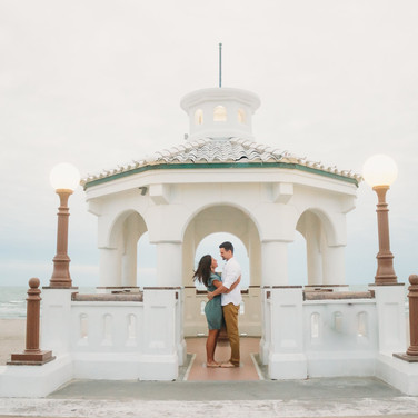 couple standing in a gazebo in front of corpus christi bay