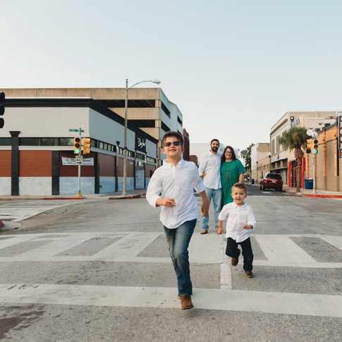 family running down the street in corpus christi texas