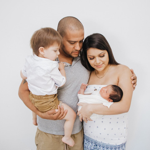Husband and wife with their newborn baby