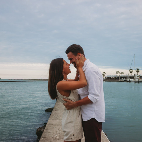 husband and wife standing in front of water in corpus christi texas