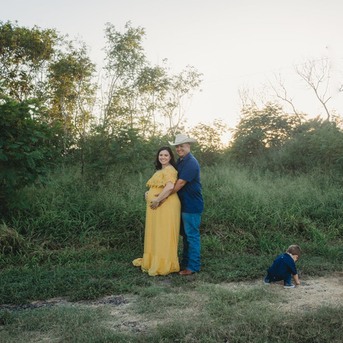 Husband hugging belly of pregnant wife