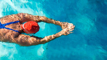 The Water's Cold: Dive In              Protecting Your Hair While Swimming